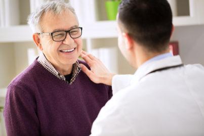 Smiling happy old prostate cancer patient visit doctor